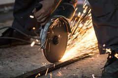 Cutting metal with grinding machine, spark stock photos