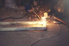 Cutting metal with many sharp sparks royalty free stock photography