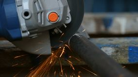 Cutting metal pipe. With angle grinder,  slow motion stock video