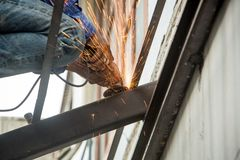 Cutting metal reinforcement rebar rods at building site. Steel cutting machine Stock Photography