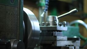 Cutting metal shaft processing on lathe machine stock footage
