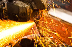 Cutting metal with sparks Royalty Free Stock Photo