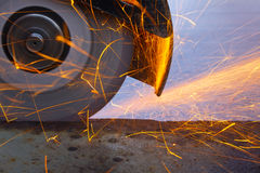 Cutting of metal with sparks. Cutting of metal with hand held cutter with sparks Royalty Free Stock Photography