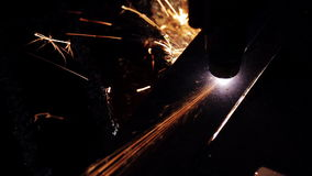 Cutting of metal. Sparks fly from laser stock video