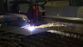 Cutting of metal. Sparks fly from plasma and metal interaction. Plasma metal cutting machine. Sparks fly from plasma and metal interaction stock video footage