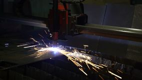 Cutting of metal. Sparks fly from plasma and metal interaction. Plasma metal cutting machine. Sparks fly from plasma and metal interaction stock footage