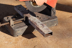 Cutting a metal and steel with compound mitre saw with sharp. Circular blade Royalty Free Stock Photos