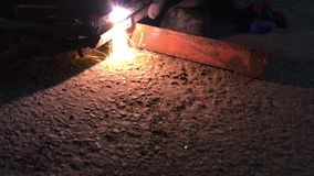 Video cutting a metal workpiece with a plasma spark cutter stock video footage