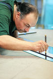Cutting a mirror Stock Image