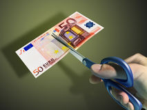 Cutting Money Stock Photo
