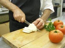 Cutting mozzarella Royalty Free Stock Image