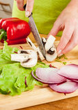 Cutting mushroom champignon Stock Images