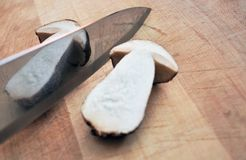 Cutting mushroom in half Stock Images