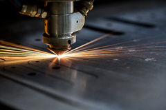 Cutting Of Metal. Sparks Fly From Laser Stock Photography