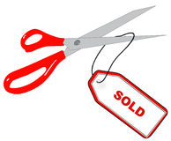 Cutting off sold tag Royalty Free Stock Photos
