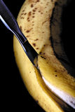 Cutting old banana with scalpel Royalty Free Stock Photography