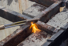 Cutting old steel with fire Stock Image