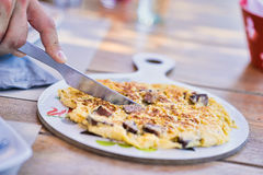 Cutting Omelette Royalty Free Stock Photo