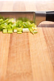 Cutting onion on chopping board Royalty Free Stock Photography