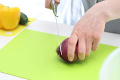 Cutting the onion into slices Royalty Free Stock Images