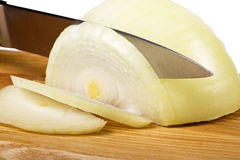 Cutting  onions Royalty Free Stock Images