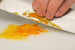 Cutting orange and citron zests Royalty Free Stock Photos