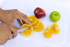 Cutting the orange fruit Royalty Free Stock Photo
