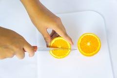 Cutting orange juice Stock Image