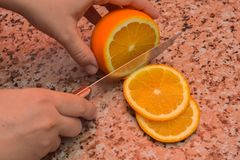 Cutting of orange royalty free stock photos