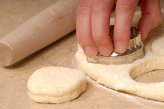 Cutting out buttermilk biscuit dough Royalty Free Stock Photos