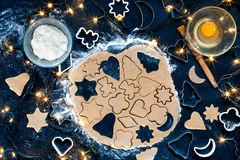 Cutting out the Christmas cookies Royalty Free Stock Photography