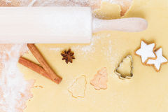 Cutting out christmas shape cookies Royalty Free Stock Photography