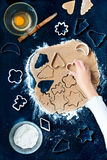 Cutting out the Christmas symbols in the dough Stock Photography
