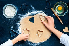 Cutting out the Christmas symbols in the dough Stock Image
