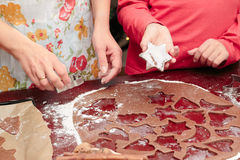 Cutting out the Christmas symbols in the dough Royalty Free Stock Image