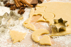 Cutting out cookies Stock Images