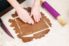 Cutting out dough for shaped gingerbread Stock Photography