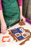 Cutting out dough for shaped gingerbread Stock Images