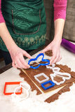 Cutting out dough for shaped gingerbread Royalty Free Stock Photos