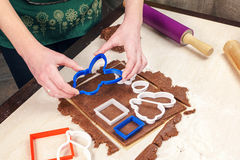 Cutting out dough for shaped gingerbread Royalty Free Stock Photo