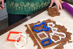 Cutting out dough for shaped gingerbread Royalty Free Stock Image