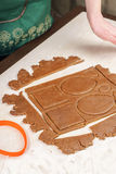Cutting out dough for shaped gingerbread Stock Photo