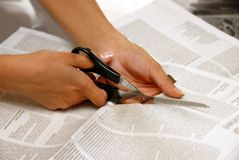 Cutting Out From Newspapers Royalty Free Stock Photography
