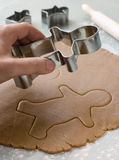 Cutting out a Gingerbread Man Stock Image
