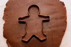 Cutting out a gingerbread man Stock Photo