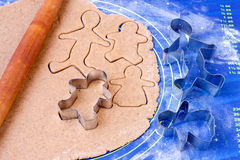 Cutting out gingerbread people Royalty Free Stock Images