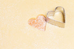 Cutting out hearts from dough. Cutting out hearts with a mold from dough Royalty Free Stock Photography