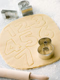 Cutting Out Number Shape Biscuits Royalty Free Stock Photography