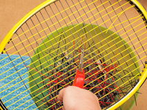 Cutting out old Tennis strings Stock Images