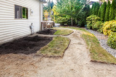 Cutting out path patio and flower beds Royalty Free Stock Photography